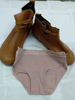 Used male shoes and one women underpant in Dubai, UAE
