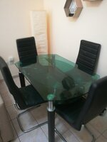Used Glass table with 4 leather chairs in Dubai, UAE