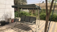 Used Marble table&6 garden chairs &swing  in Dubai, UAE