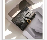 Used Dior Saddle card bag in Dubai, UAE