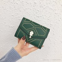 Used New green snake head wallet with stones in Dubai, UAE