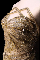 Used Golden white color luxury evening dress  in Dubai, UAE
