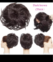 Used Dark brown to black hair bun extension  in Dubai, UAE
