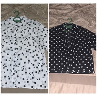Used New! 2 dotted blouses fits M/L in Dubai, UAE