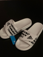 Used Adidas slippers white size 43, new in Dubai, UAE