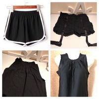 Used 2 shorts size L/XL & 1 black top size S in Dubai, UAE