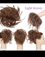 Used Light auburn to dark brown bun hair  in Dubai, UAE