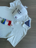 Used Tommy Hilfiger Polo L with New cap  in Dubai, UAE