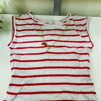 Used red and white top for girls in Dubai, UAE