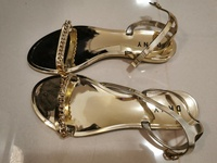 Used Brand new Dkny golden sandals size 39 in Dubai, UAE