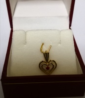 Used 10k Solid Gold heart pendant new with cz in Dubai, UAE