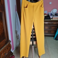 Used Passion yellow small size trousers in Dubai, UAE