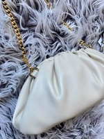 Used Pleated leather clutch/sling bag in Dubai, UAE