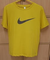 Used Nike t shirt for him yellow ! in Dubai, UAE