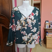 Used Floral ling sleeves top size S/M in Dubai, UAE
