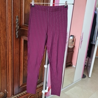 Used FOREVER21 maroon color Strechable pants in Dubai, UAE