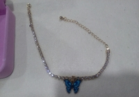 Used Butterfly rhinestone anklet with box New in Dubai, UAE