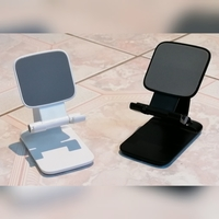 Used Foldable phone holder stand black and wh in Dubai, UAE