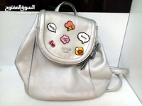 Used Guess bag pack silver color in Dubai, UAE