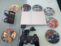 Used PS2 Slim with one controller + 15game cd in Dubai, UAE