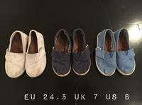 Used TOMS 3 Pairs Of Shoes. White, Navy And Blue. Super Cute. Good Condition. Easy To Put On. Original Price Of Each 199 Aed. Good Condition. in Dubai, UAE
