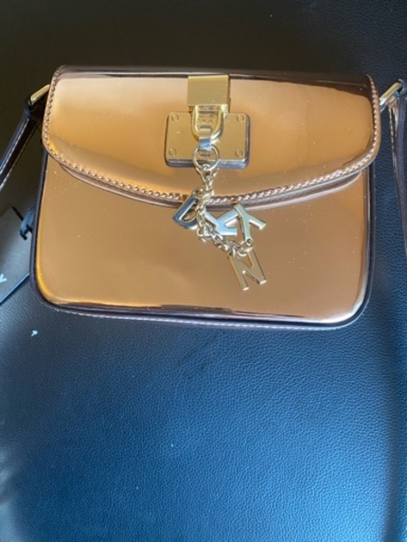 Used Authentic DNKY brand new gold bag in Dubai, UAE