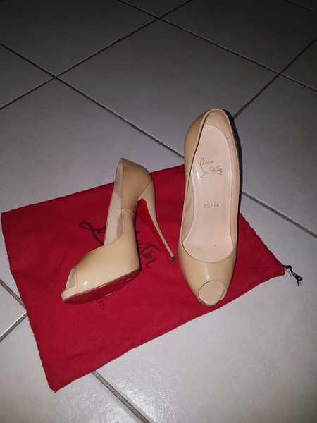 Used christian louboutin peep toe nude heels in Dubai, UAE