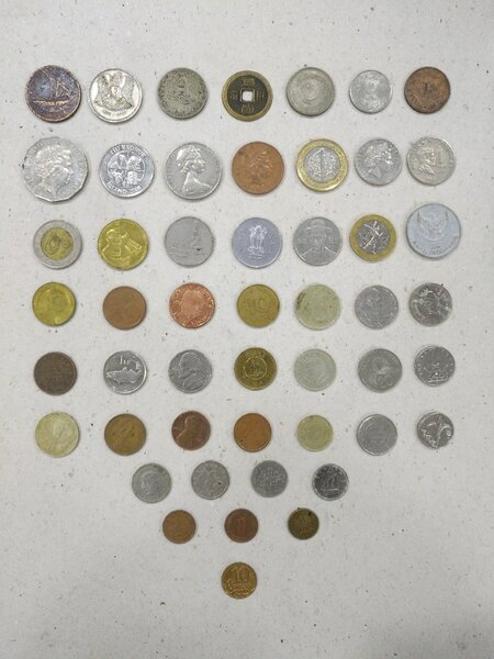 Used 50 coins different country in Dubai, UAE