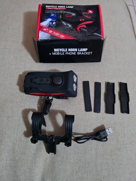 Used New bicycle phone holder/charger & light in Dubai, UAE