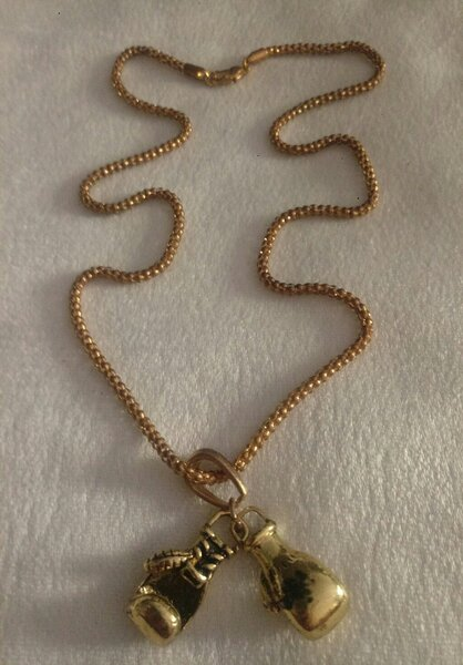 Used boxing gloves necklace gold look New in Dubai, UAE