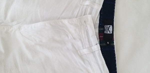 Used 2 men shorts ( white & green) in Dubai, UAE