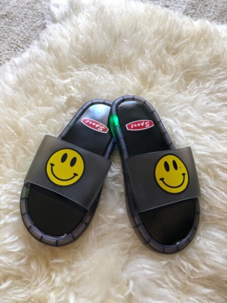 Used Kids smiley face slippers LED 34/35 in Dubai, UAE
