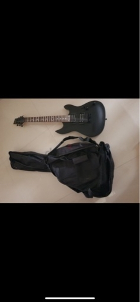 Used Electric guitar with bag and stand in Dubai, UAE