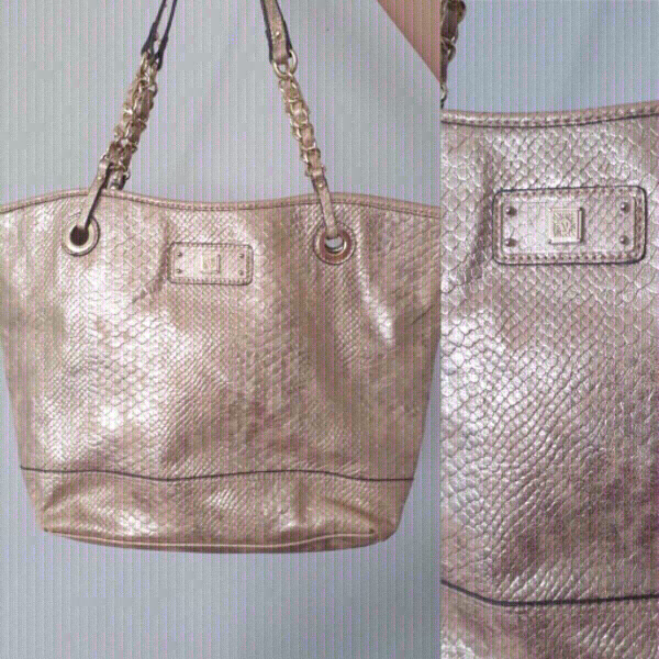 Used authentic ANNE KLEIN metallic python bag in Dubai, UAE
