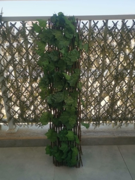 Used Expandable wicker fence with faux plants in Dubai, UAE