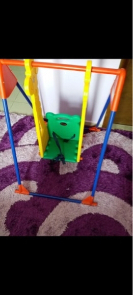 Used Baby swing with safety belt easy to fix in Dubai, UAE