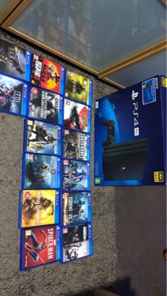 Used Ps4 pro in perfect condition+14 games in Dubai, UAE