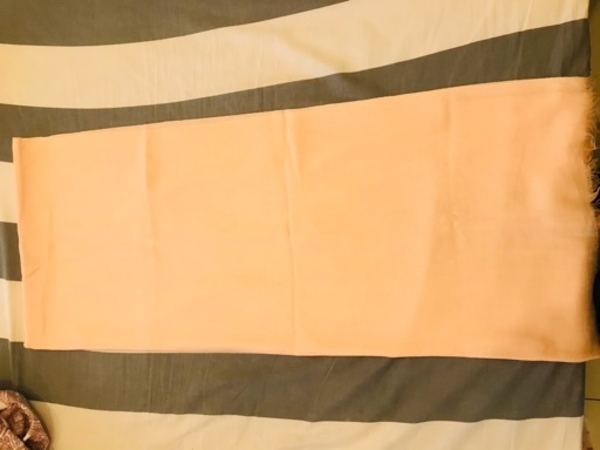 Used Headscarf not used, light orange colour in Dubai, UAE