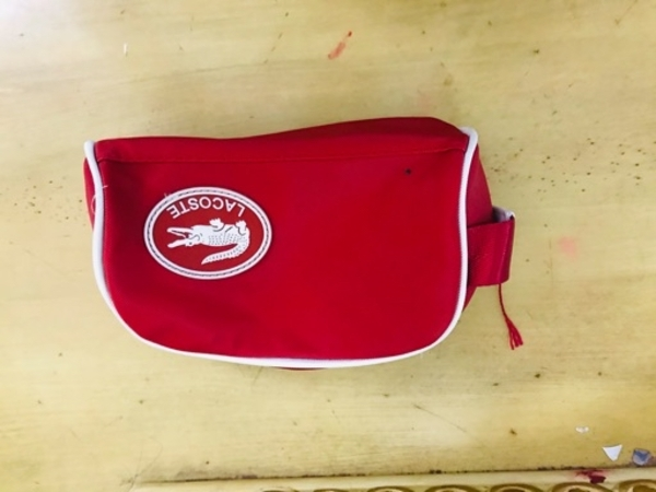 Used Lacoste hand pouch in Dubai, UAE