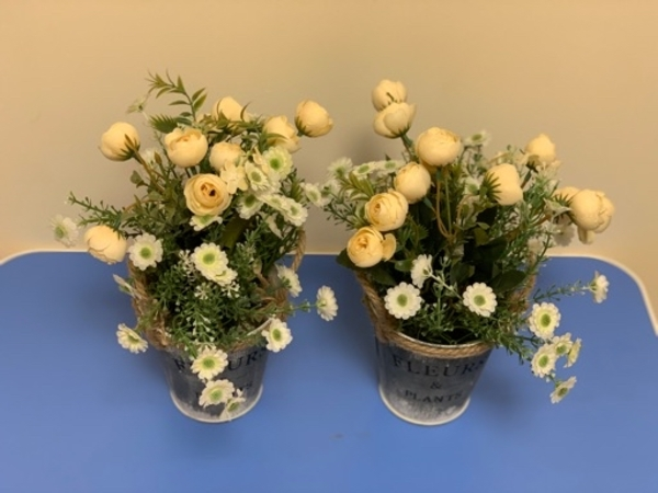 Used Artificial flower with cute flower pot in Dubai, UAE
