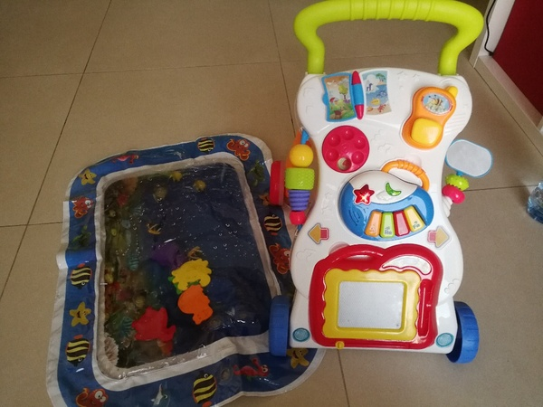 Used 2 in one. Baby Pusher and water mat in Dubai, UAE