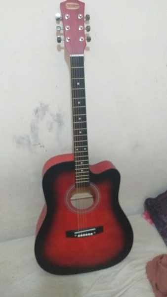Used 40inch Acoustic Guitar (Red and Black) in Dubai, UAE