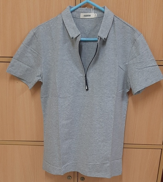 Used Grey T shirt for him in M size ! in Dubai, UAE