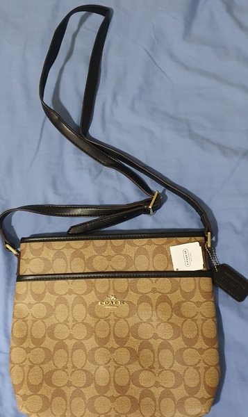Used Coach sling bag unwanted gift in Dubai, UAE