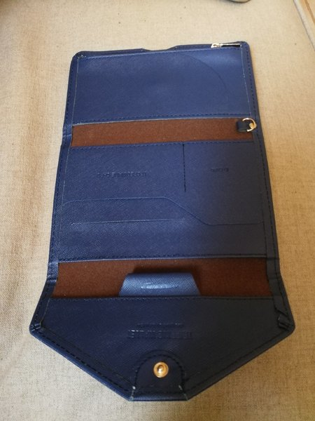 Used Blue Trips wallet, good for travellig in Dubai, UAE