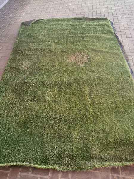 Used Artificial grass has one stain in Dubai, UAE
